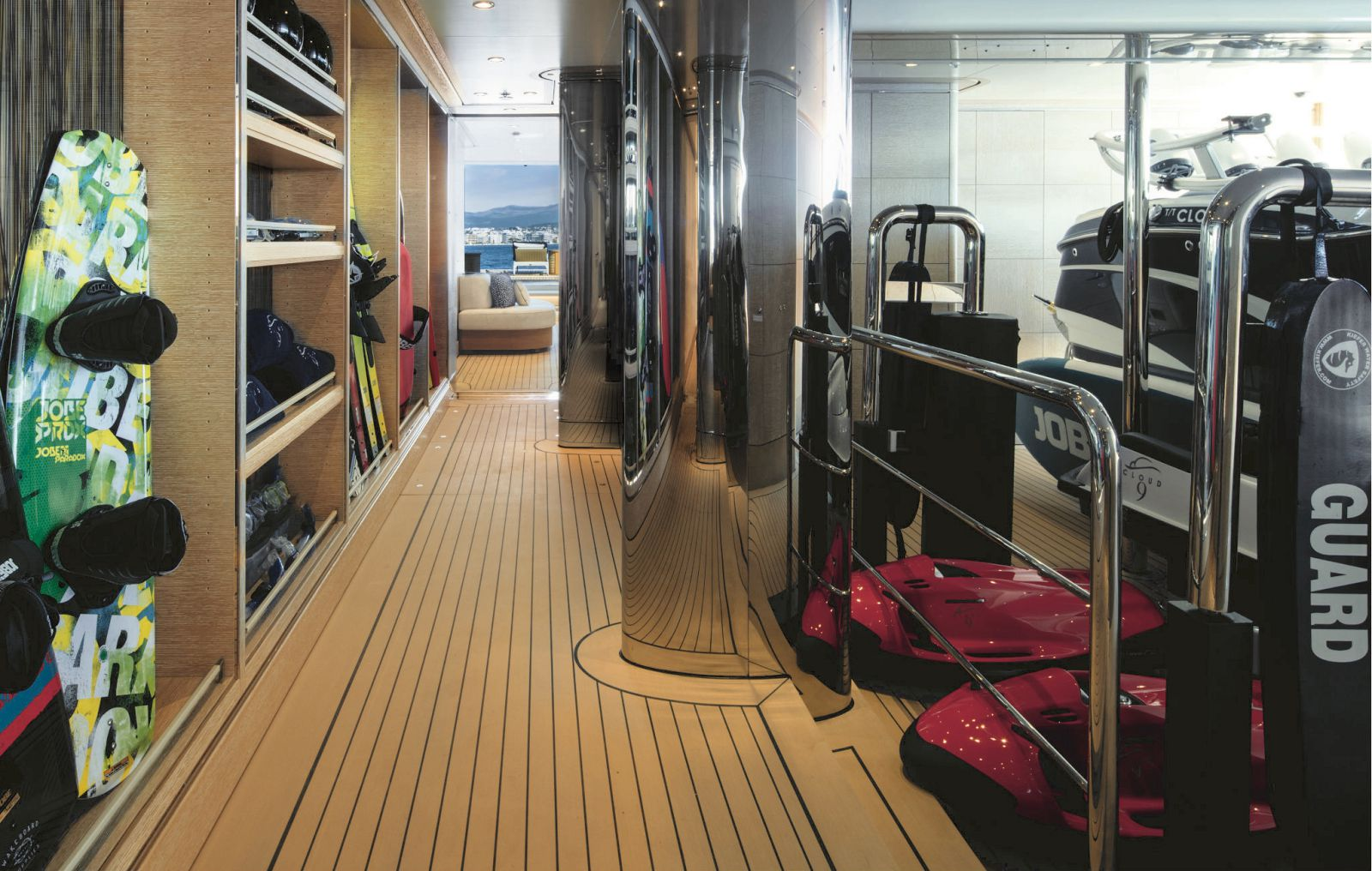 Storage garage with sea bobs, wakeboards, water skis and tender. >