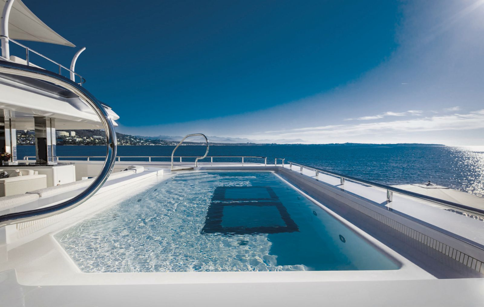 Long outdoor pool on the aft deck. >