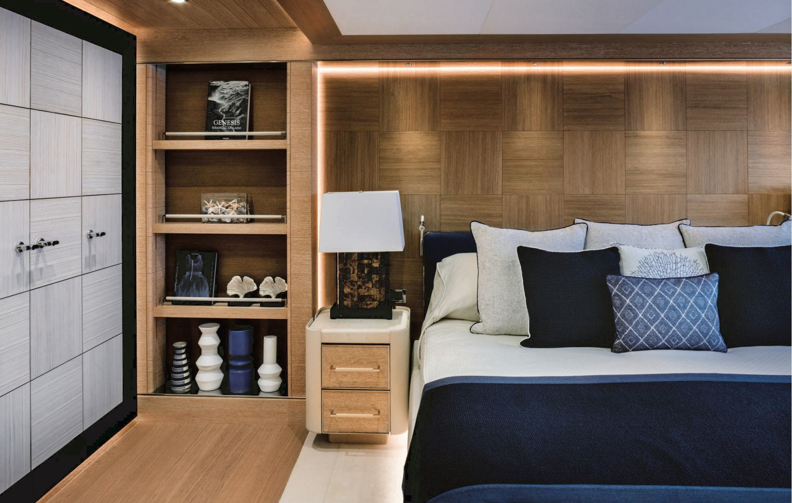 Cabin bed, side table, book shelf and closet. >