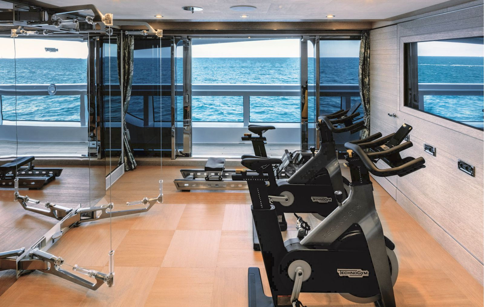 Interior gym looking out the starboard of the boat. >